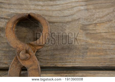 Overhead close up of wire cutter on wooden table