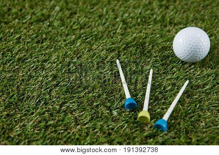 Close up of golf ball with tee on grassy field