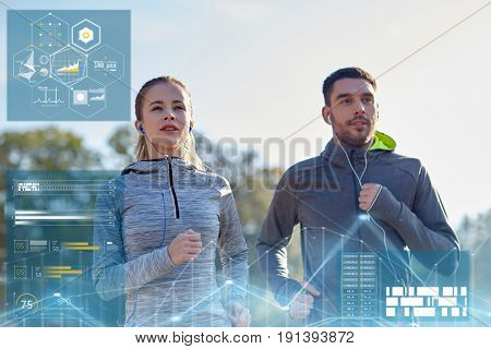 fitness, sport and people concept - happy couple running and listening to music in earphones outdoors