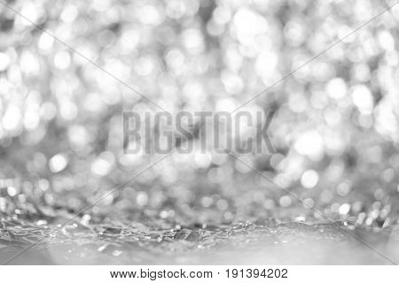 Defocused lights abstract grey round bokeh from aluminum foil background