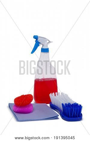 Detergent spray bottle, scrubber, napkin cloth and brush arranged on white background