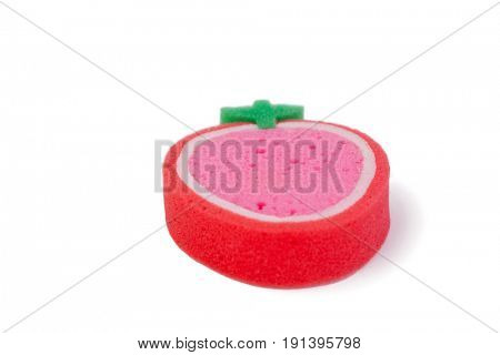 Close-up of strawberry shaped scouring pad on white background