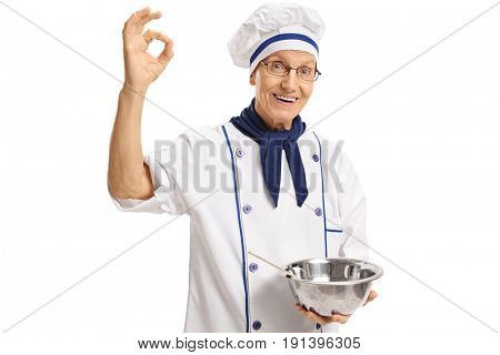 Chef holding a bowl and making an ok sign isolated on white background