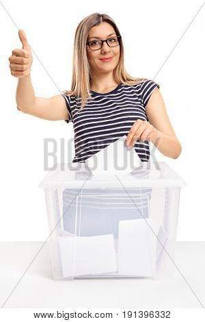 Young woman voting and making a thumb up gesture isolated on white background