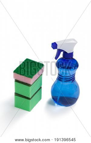 Cleaning spray bottle and stack of scrubber on white background