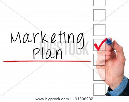 Business Man Hand  Writing Marketing Plan Concept And Ticking Check List