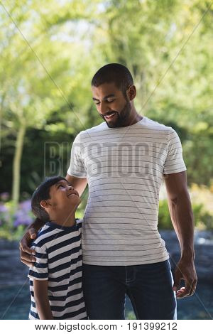 Smiling young man with his son standing at porch
