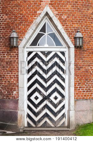 Wooden Door In Red Brick Wall, Gothic Revival