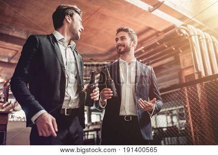 Businessmen In Bar