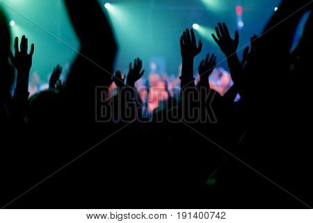 Crowd raises hands to rock band/Hip hop group