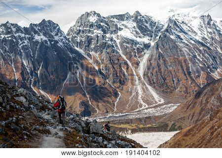 Trekker goes down fron Larke La pass on Manaslu circuit trek in Nepal
