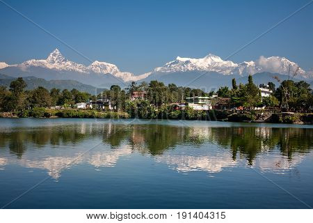 View at Annapurna mountain range and its reflection in Phewa lake in Pokhara Nepal