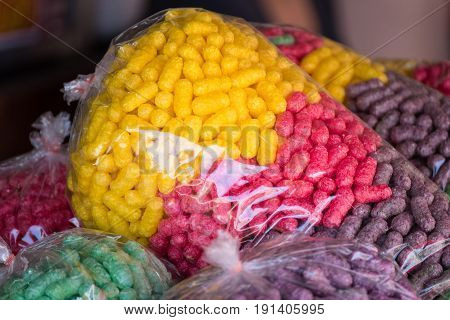 Feeding Fish, Colourful Food For Fish Made From Corn In A Plastic Bag, Popular For Feeding The Fish