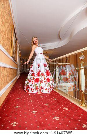 Portrait of attractive blonde woman indoors
