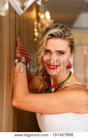 Portrait of attractive blonde woman in jewelery
