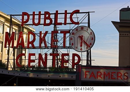 SEATTLE USA - MARCH 25 2016: Pike Place Market on March 25 2016 in Seattle USA. Pike Place public market sign at sunset.