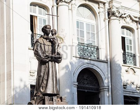 LISBON PORTUGAL -JUNE 13 2017: Statue of Saint Anthony of Lisbon in front of the Saint Anthony church in Lisbon.