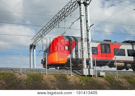 Modern suburban electric train in motion. Moscow. Russia.
