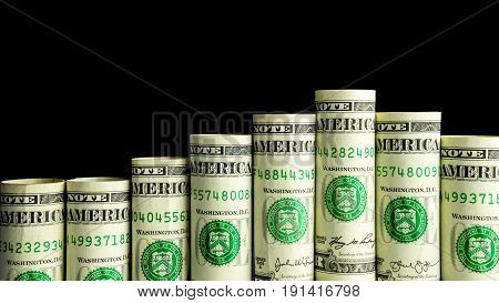 Rolled dollar banknote with black background isolated money staircase