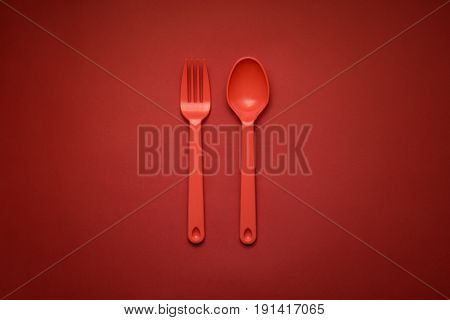 Red Fork & Spoon On Red Background