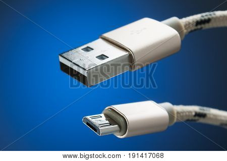 Cable micro-USB to USB connector. blue background