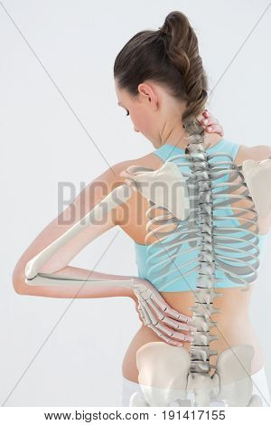 Digitally generated image of woman suffering from neck pain against white background