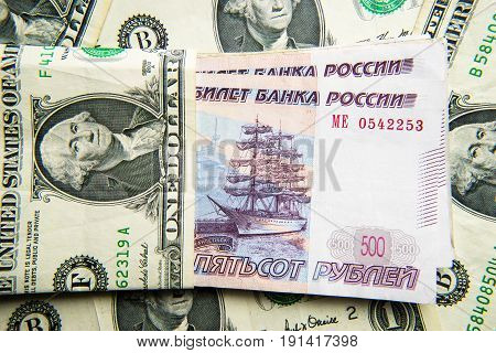Dollar money versus russian rubles banknotes, detail
