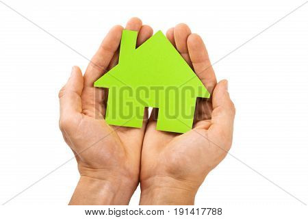 hands holding green house isolated on white background