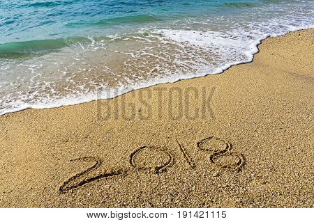 Handwritten Number 2018 On A Beach With Waves - Happy New Year Concept.