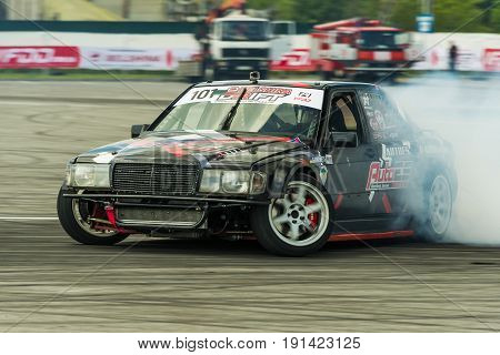 Lviv Ukraine - June 4 2016: Unknown rider on the car brand Mercedes-Benz overcomes the track in the championship of Ukraine drifting in Lviv Ukraine.