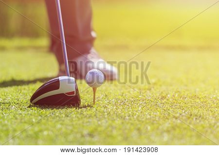 A Man Playing Golf In Green Course. Focus On Golf Ball.