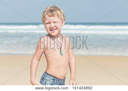 Caucasian Boy From Europe With Happy And Relax Time On The Tropical Beach At Karon, Phuket, Thailand