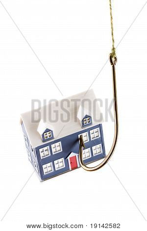 House on a fishing hook isolated
