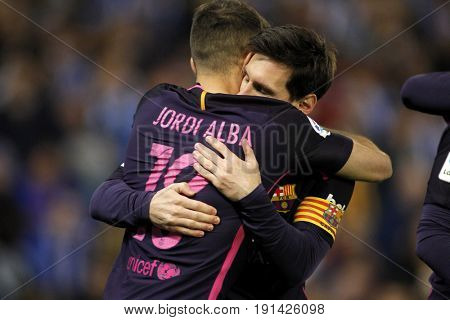 BARCELONA, SPAIN - APRIL, 29: Messi and Jordi Alba of FC Barcelona celebrating goal during a Spanish League match against RCD Espanyol at the RCDE Stadium on April 29 2017, in Barcelona Spain