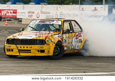 Lviv Ukraine - June 4 2016: Unknown rider on the car brand BMW overcomes the track in the championship of Ukraine drifting in Lviv Ukraine.