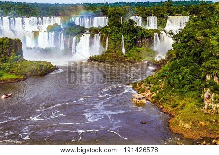 Boiling water creates a watery dust and a rainbow. Several waterfalls from 275 Falls. The concept of exotic and extreme tourism