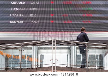 Stock Market Data Displayed On A Outdoor Screen In Canary Wharf