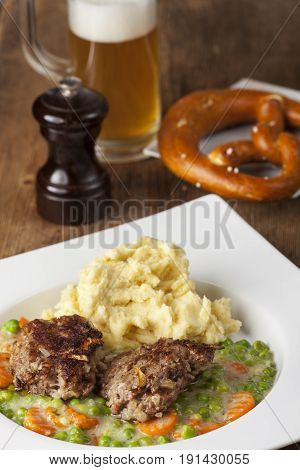 bavarian homemade meatballs with mashed potato and beer