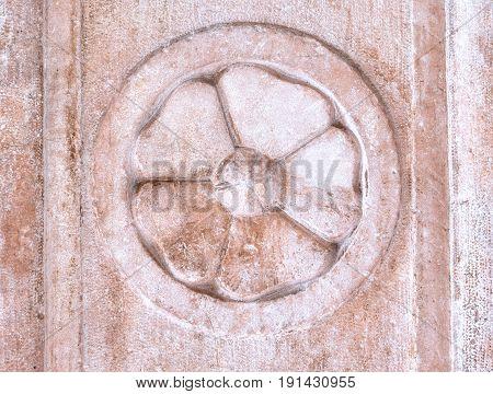 Architectural elements of the facade, vintage wall texture rosette. Vittorio Veneto, Italy