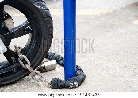 Motorcycle Locked With A Chain To Prevent Theft