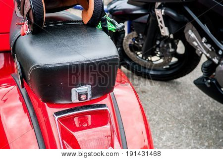 Retro Style Red Motor Scooter With Crash Helmet