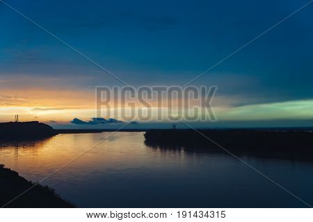 Colorful bright sunset landscapes of the Altai Territory. Sunset reflected in the river Ob.