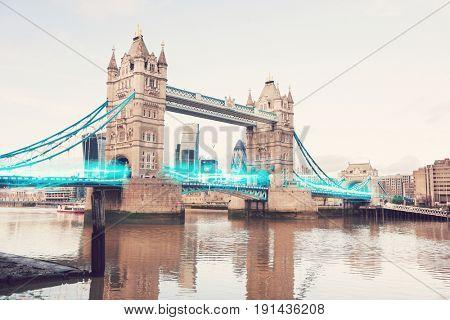 Blue streak of lights passing through Tower Bridge