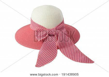 Woven hat with pink, beige, decorated with a pink bow tie, isolated on white background.