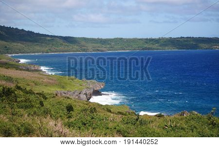 Laulau Bay coastline, Saipan Beautiful coastline of Laulau Bay with lush greenery and steep cliff lines, Saipan, Northern Mariana Islands