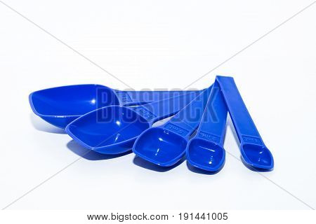 Close up set of modern plastic measuring spoons isolated on white background