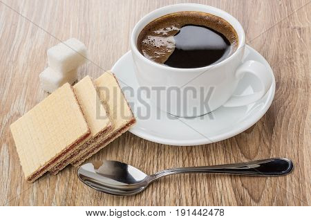 Coffee In Cup On Saucer, Spoon, Waffles And Lumpy Sugar