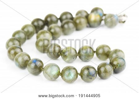 necklace of large labradorite beads on a white background