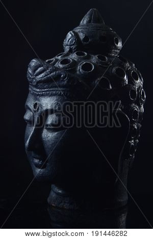 Budha head statue of sidharta gautama made from clay