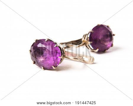 Vintage earrings with alexandrite stone on white